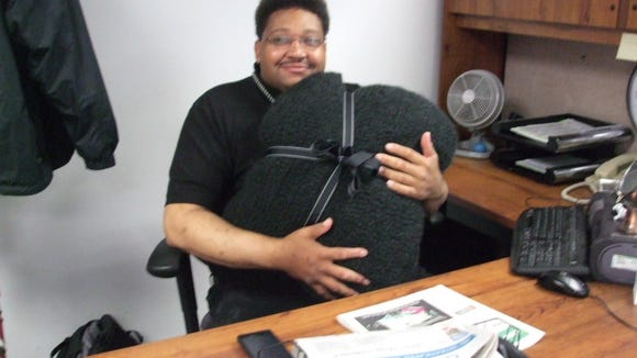 Here's Jay a few years ago with the blanket that I made with several prayer-shawling friends. We had an extra strip, so I sewed it into a bag to hold the blanket.