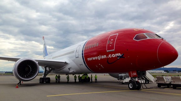 A Norwegian Air jet is refueled.