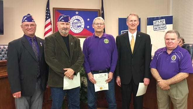 Shown from left are members of the Military Order of the Purple Heart Chapter 530: Sammy Lewis, Phil Harris, Stan Brown; Mayor Frank Crenshaw; and John Foster.
