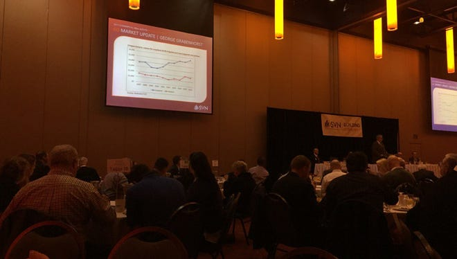 Attendees listen to news of economic conditions in Salem.