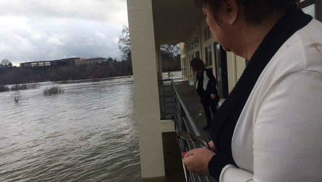 Kate Mumm, billing manager at WellnessOne of Redding, said the water levels almost reached the business' deck on Tuesday.