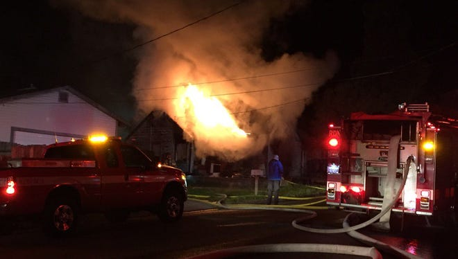 Two people were hospitalized after a house caught fire near downtown Redding on Monday night.