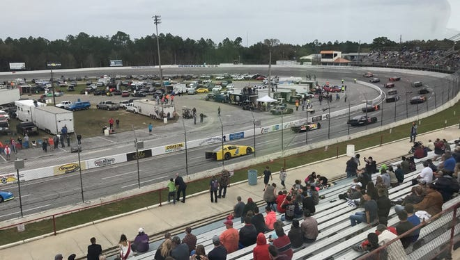 The Outlaw Stock cars head into Turn 1 for the start of Sunday's race in the season-opening day of racing at Five Flags Speedway.