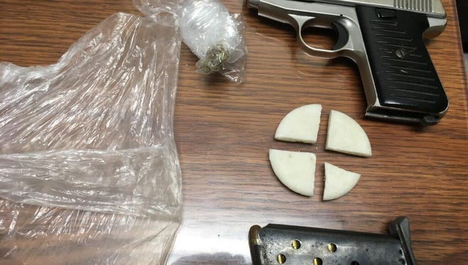 Police recovered drugs and a stolen handgun from Darrell Young during a traffic stop Wednesday.