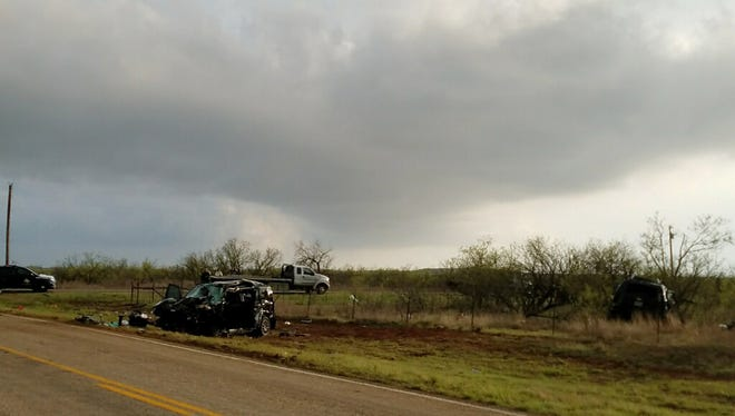 Texas Department of Public Safety troopers investigate a two-vehicle crash that left several storm chasers dead Tuesday , March 28, 2017, near Spur, Texas. Tornadoes had been reported nearby at the time of the crash and heavy rain had been reported in the area, according to the National Weather Service.