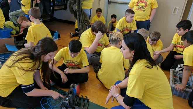 The East Rutherford robotics team and advisers work out the kinks in their robot before the South Bergen Robotics Competition in Carlstadt on March 29.
