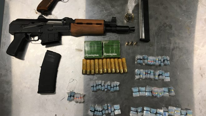 Police found heroin and loaded guns inside a home as part of an ongoing drug investigation.