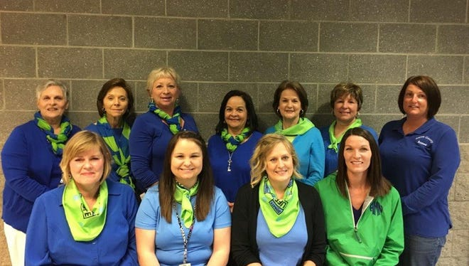 Employees of the Union County Circuit Clerk's office, Drug Court and Judicial Secretary show off their blue and green in support of Donate Life America.