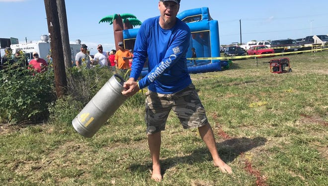 A patron at Corpus Christi Brewery Festival prepares to toss a keg.