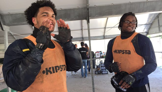 Carlo Kemp and Rashan Gary, right, during the paintball competition.