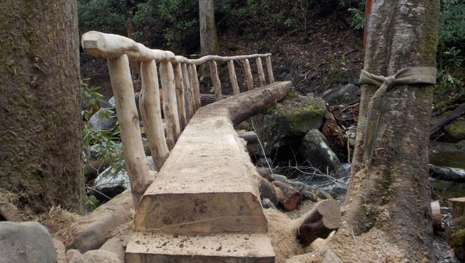 This foot bridge on the Ramsay Cascades Trail in Great Smoky Mountains National Park replaced one that had been damaged when a tree fell on it last summer.