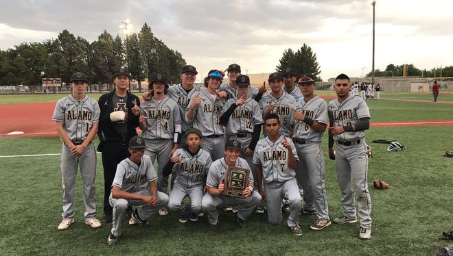 The Alamogordo baseball team poses with their District 3-5A championship plaque Friday evening.