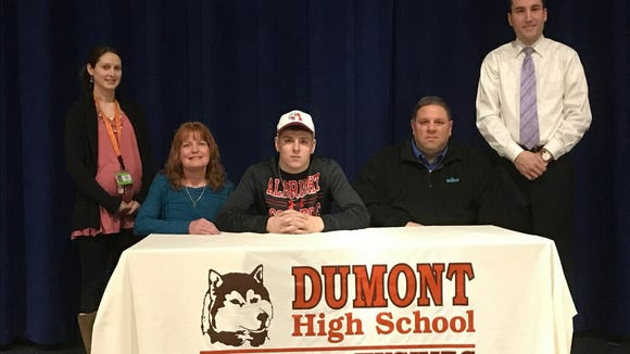 Matthew Monteverde has signed to play football in the fall at Albright College in Reading, Pa. From left: guidance counselor Tara Torres; Margaret Monteverde, Matthew's mother, Monteverde; John Monteverde, Matthew's father; and Athletic Director Michael Oppido.