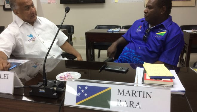 Guam National Olympic Committee president RIcardo C. Blas discusses the workshop with Martin Rara of the Solomon Islands. The workshop drew together representatives from all of Oceania.