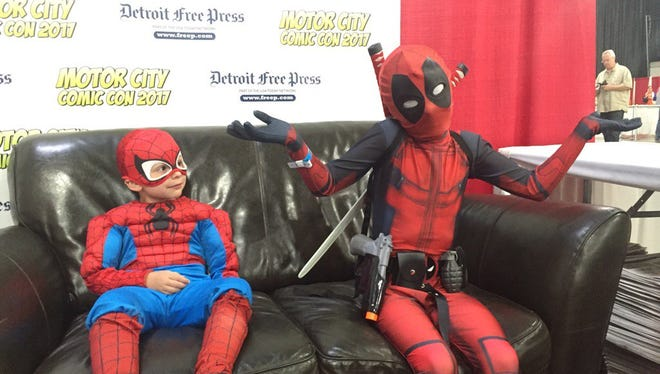 Spidey and Deadpool (Nikolas and George Kallas of Northville) at Motor City Comic Con at the Suburban Collection Showplace in Novi.