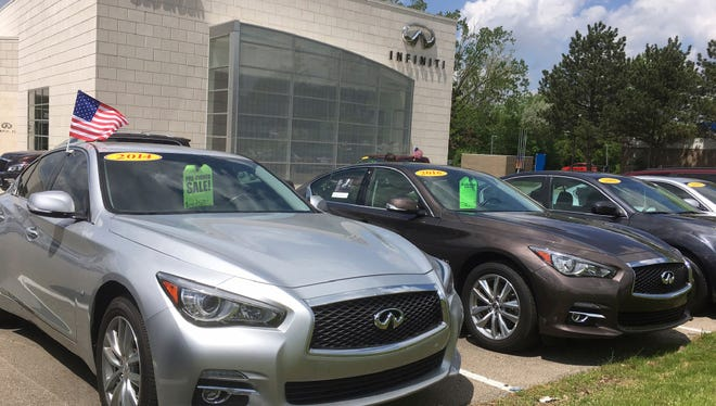 In this Wednesday, May 17, 2017, photo, used Infiniti Q50 luxury sedans await buyers at a dealership in the Detroit suburb of Novi, Mich. Leases are ending on a large number of Q50s and other cars, flooding the market with quality used cars.