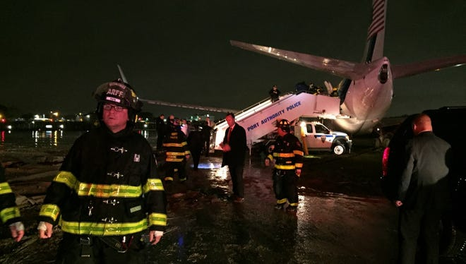 The campaign plane of Republican vice presidential candidate Indiana Gov. Mike Pence sits off a runway at New York's LaGuardia Airport on Oct. 27, 2016, after it slid off a runway during a rainstorm during landing.