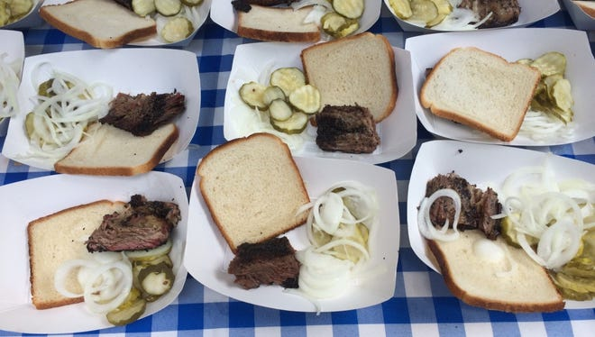 Hometown serves smoked beef short rib with pickles and onions.