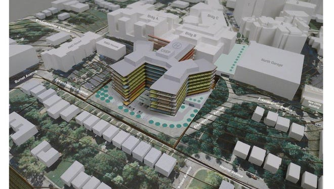 Model shows proposed expansion of Children's Hospital to the north across existing Erkenbrecher Avenue.