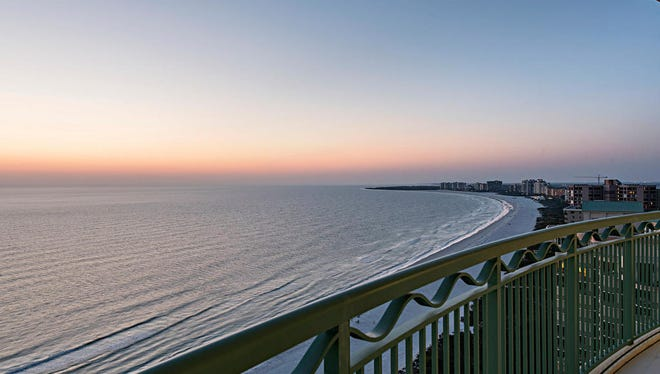 Marco Island at sunset from the balcony of Veracruz 2003 at Cape Marco listed at $2.995 million.