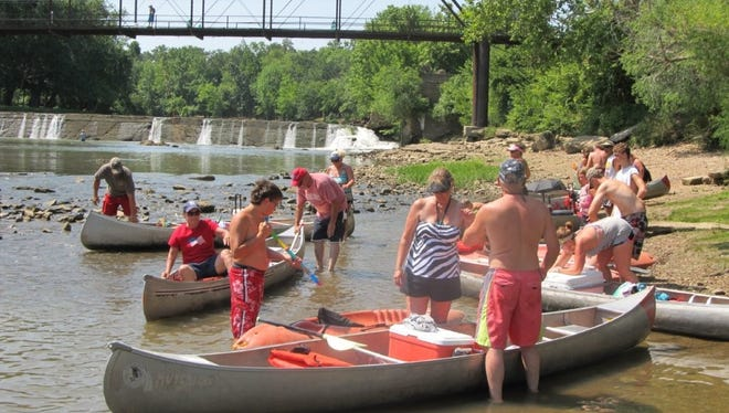 A group of floaters getting ready to float the Sac River below the dam at Caplinger Mills.