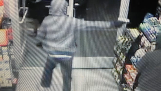 Photos from a surveillance camera of three men wanted in connection with a Lower Valley convenient store robbery.