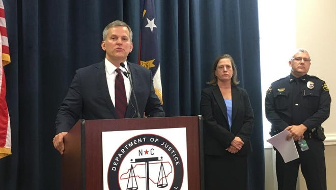North Carolina Attorney General Josh Stein speaks to reporters on Thursday, Aug. 3, 2017, in Raleigh, N.C. Stein describes his decision to lay off about 9 percent of his agency's attorneys as well as about two dozen other staffers as a result of a $10 million budget cut forced on the Democrat by the Republican-dominated General Assembly.