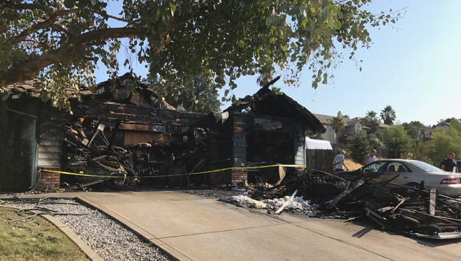 An early morning fire Friday on Americana Way destroyed the home's garage.