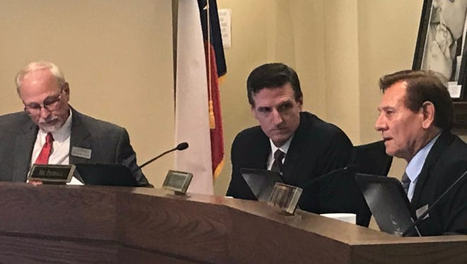 Abilene Independent School District trustees, from left, Dr. Danny Wheat, Randy Piersall and Bill Enriquez, discus single-member districts during board meeting on Monday, Aug. 14, 2017.