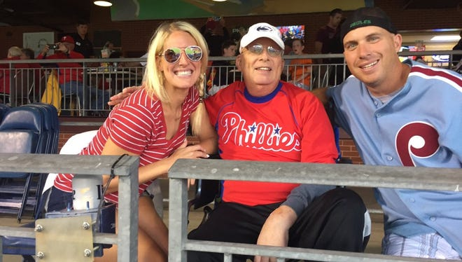 Gary Rohrbach, with daughter Katie and son Mike at a Phillies game last month, passed away late Saturday night after a battle with brain cancer.