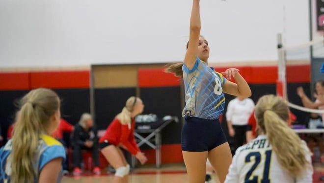 St. Mary Catholic's Sydney Andersen sends a shot over to Sheyboygan South during a volleyball match at the Lourdes Academy Invite on Saturday.