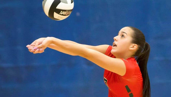 Berlin's Kara Block bumps a set ball during a volleyball match at the  Lourdes Academy Invite on Saturday in Oshkosh.