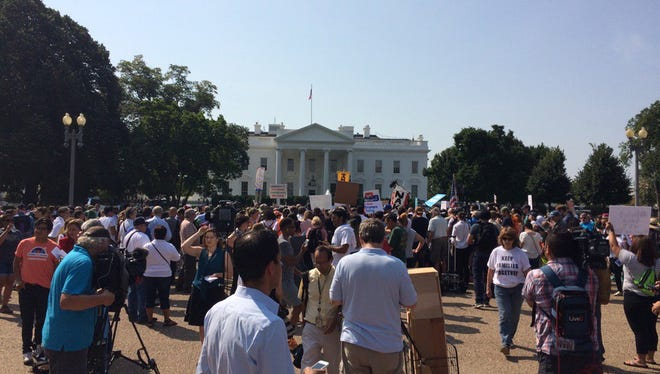 Protesters gather in front of the White House as decision to rescind DACA is announced.