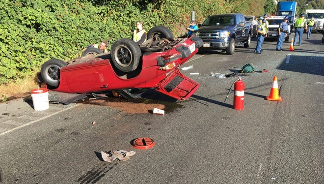 The remains of a Porsche Targa after it struck a jersey barrier and rolled over on Highway 3 Tuesday morning.