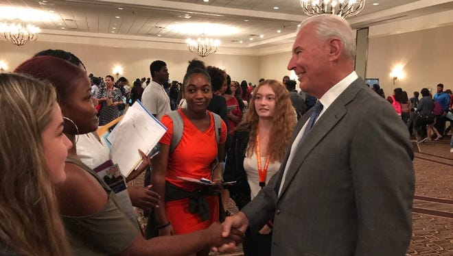 Wilmington Mayor Mike Purzycki talks to high school students at an HBCU fair held by the city Sept. 22.