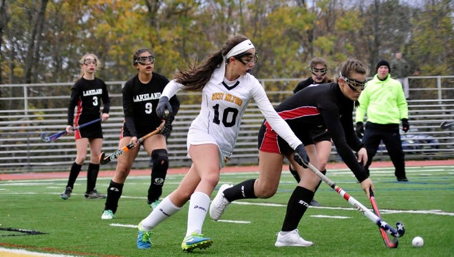 Danielle Dellapi (10) and the West Milford field hockey team captured their second-straight Passaic County Tournament title last Friday night.