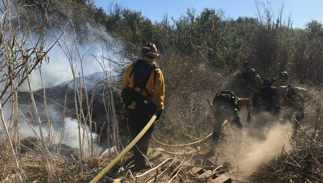 Crews battle a brush fire in Ventura. Facing a brush clearance deadline of June 1, landowners are working with local agencies to turn their fire hazards into mulch.