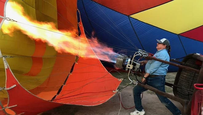 Darrell Fear, 64, of Artesia readies his hot air balloon during a September rally in Lubbock.