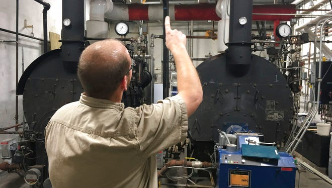 Des Moines County Maintenance Supervisors Rodney Bliesener points out how air flows up from the county courthouse's boilers to the rest of the building in Burlington, Iowa. When the boilers are running, the smell plaguing the courthouse seems to subside.