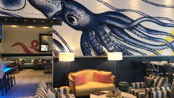 Eye-catching murals of giant sea creatures are a highlight of Izzy's decor.