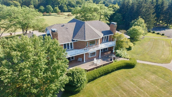 Sitting on more than 29 acres of land, this property includes plenty of outdoor features: apple trees, a large pond, lush grasses and a tennis court. Inside the 6,433-square-foot home comes four bedrooms, four full bathrooms and a five-car attached garage.