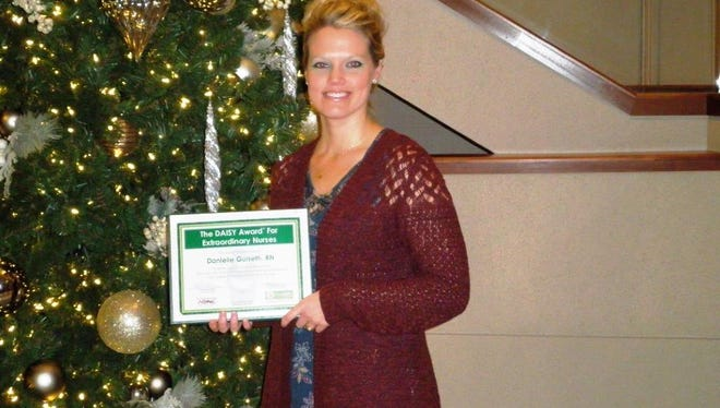 Danielle Gulseth, a registered nurse at Aurora Medical Center in Manitowoc County, was recently presented with a quarterly DAISY Award.