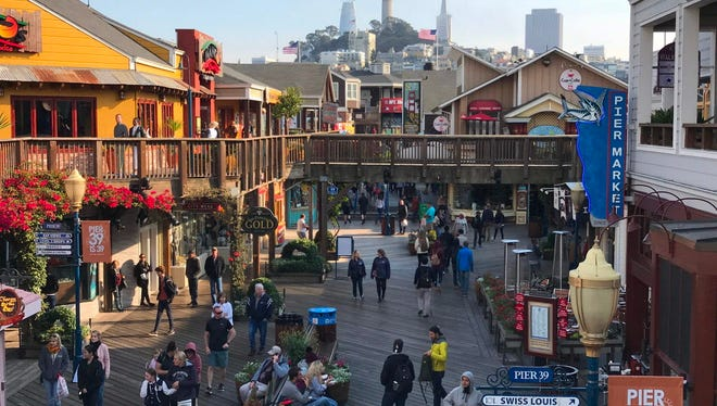 Tourists stroll on Pier 39 at San Francisco Fisherman Wharf  Oct. 18, 2017.