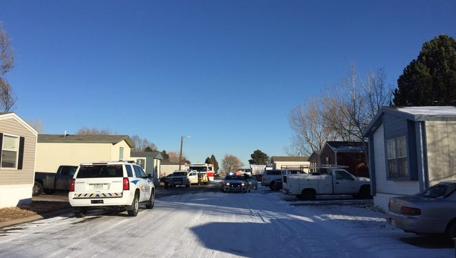 Sheriff's deputies are responding to the report of shots fired in a mobile home park on north Timberline Road