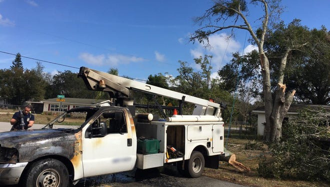 a tree-trimming truck caught fire in Mims Monday.