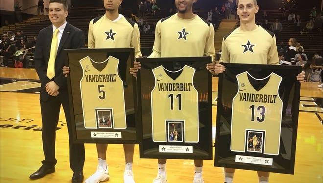Vanderbilt seniors Matthew Fisher-Davis, Jeff Roberson and Riley LaChance pose with their jerseys before senior night against Missouri on Feb. 27, 2018.