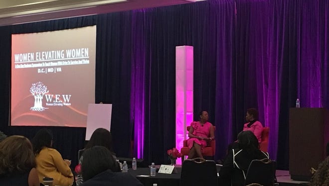 Women Elevating Women Founder and CEO Betty Hines and keynote speaker Avis Yates Rivers chat about being entrepreneurs at the Women Elevating Women Symposium in College Park, Maryland, on March 6, 2018.