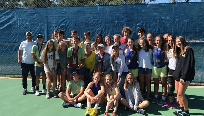 The Gulf Breeze boys and girls tennis teams both won a District 1-3A championship Tuesday at Shoreline Park.