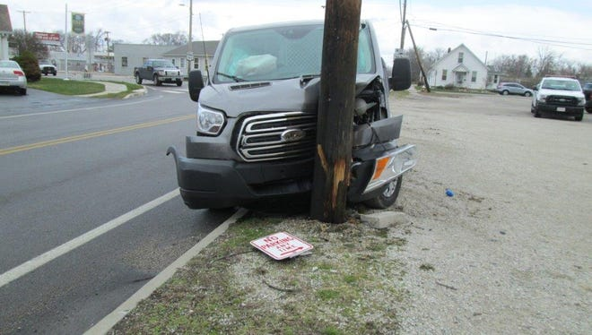 A van crashed into a utility pole in the 200 block of Benton Street and a water main was damaged by crews repairing the pole, according to police.