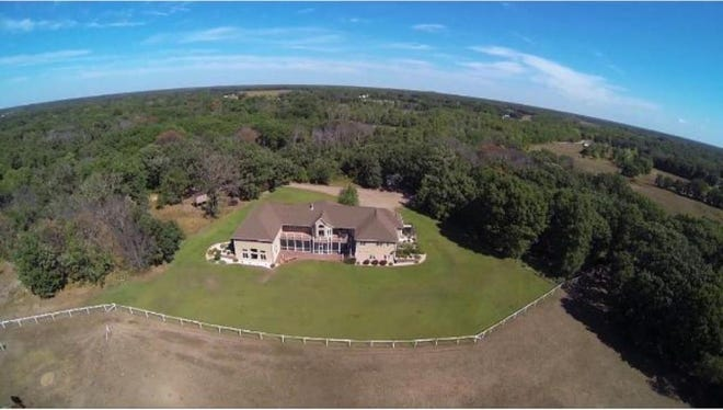 The house serves as the main hub for this beautiful property filled with mature trees. Just out from the house begins white vinyl fencing that ultimately surrounds 20 pastured acres of land with auto water for convenience.